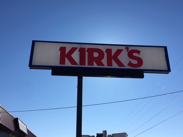 Kirk's illuminated sign