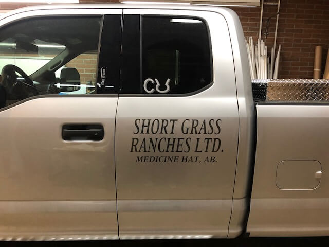 Short grass ranches Ltd letter sign for car