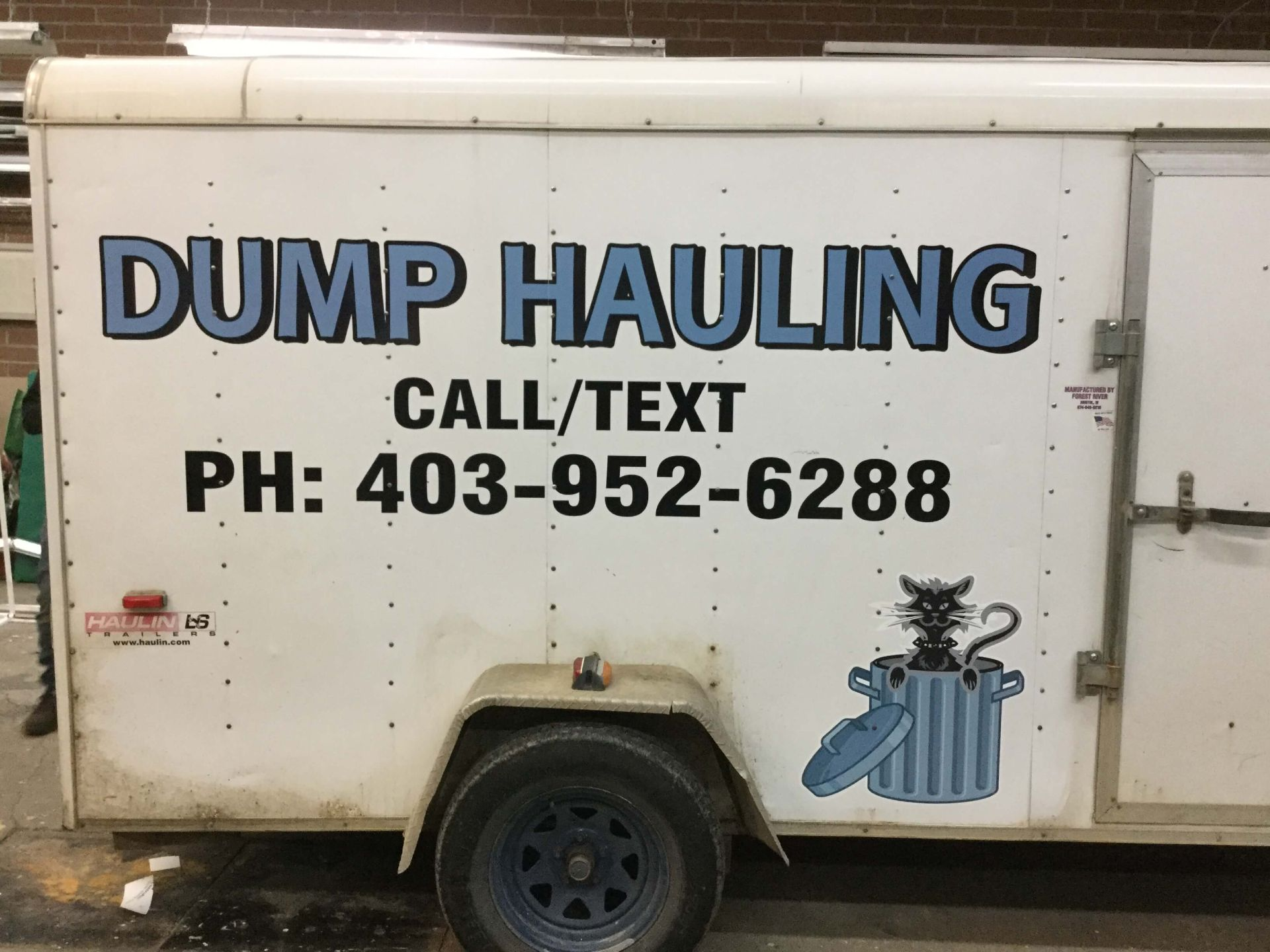 Dump hauling on a trailer
