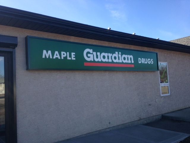 maple Guardian Drugs illuminated sign