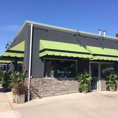 green with black stripe awning
