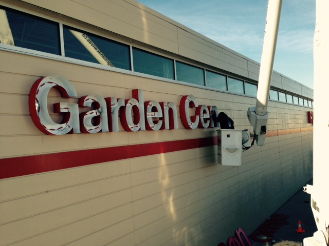Garden Centre signage being installed